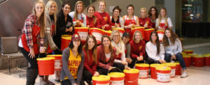 Volunteers with donation bucket at a fundraising event