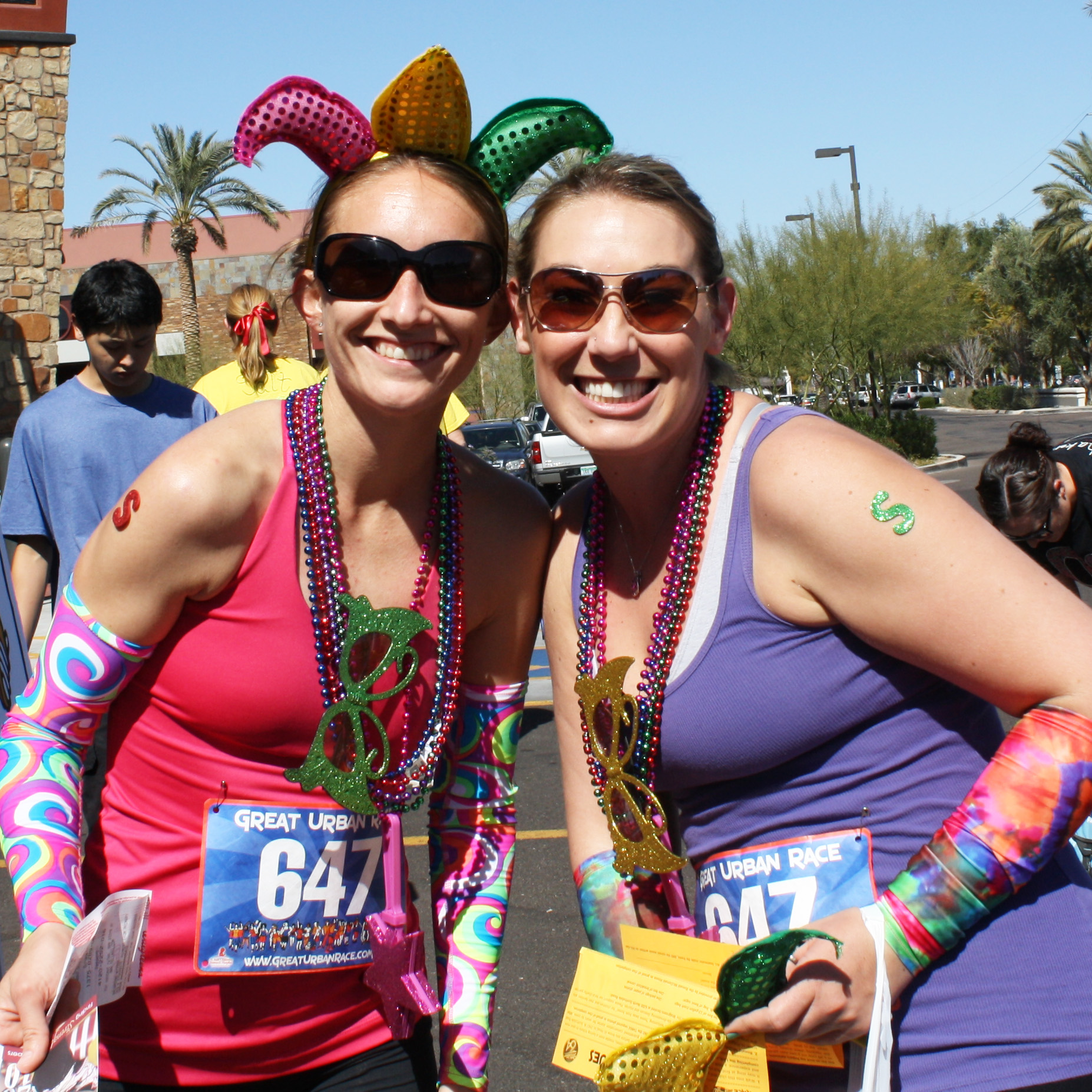 Two women dressed up in colorful gear for a 5k race