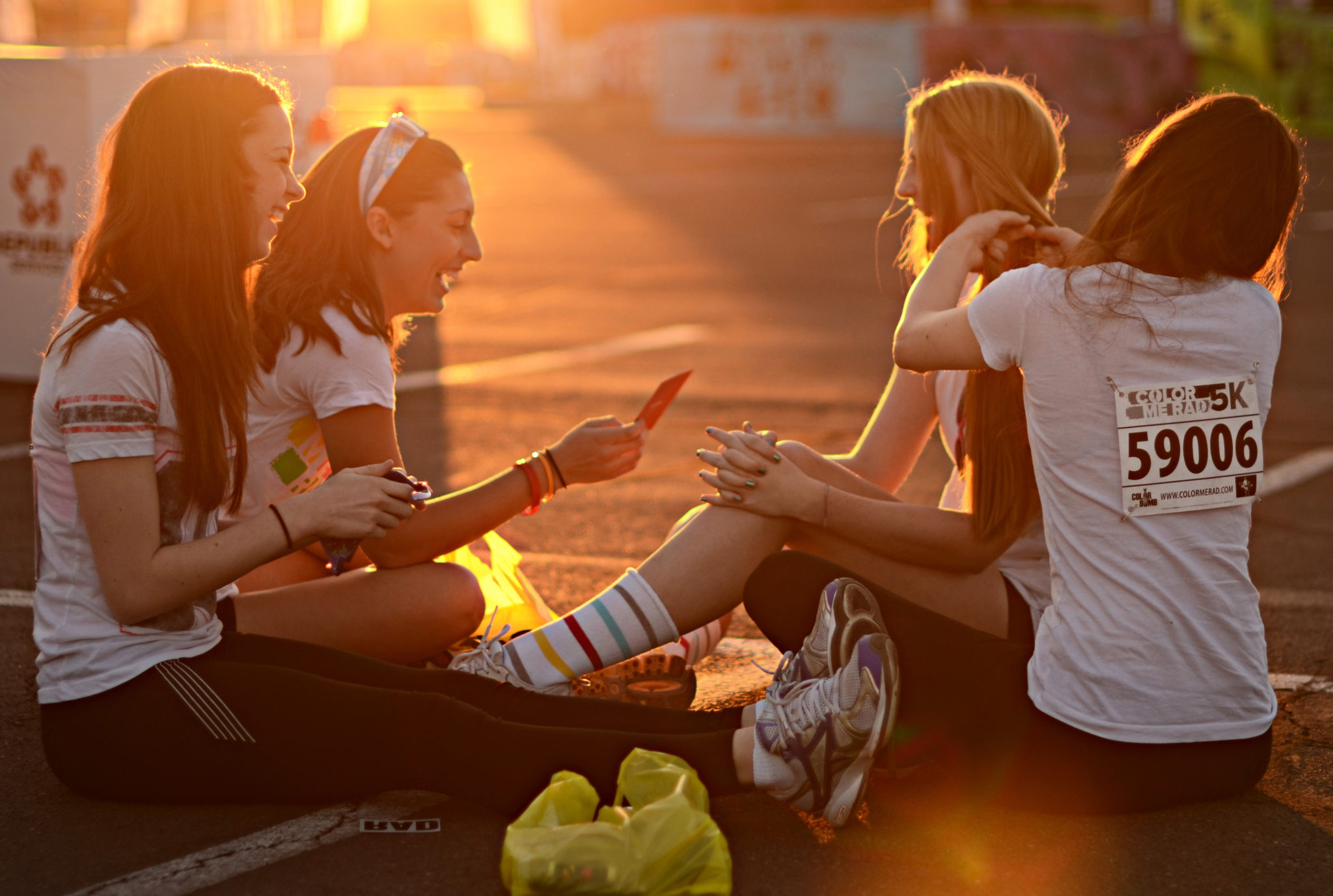 Four teen girls sit and talk before the Color Me Rad 5K that benefitted RMHC of Central and Northern Arizona