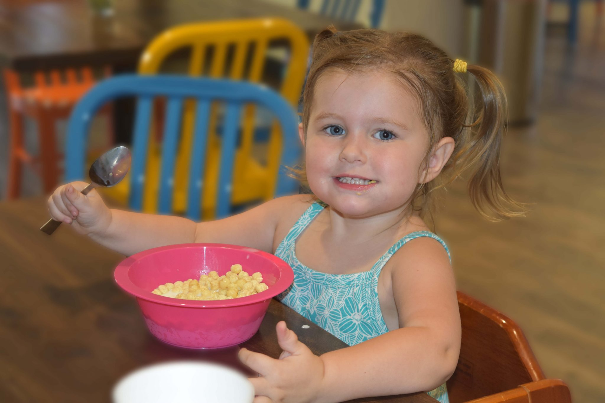 Girl enjoying a bowl of cereal in the kitchen