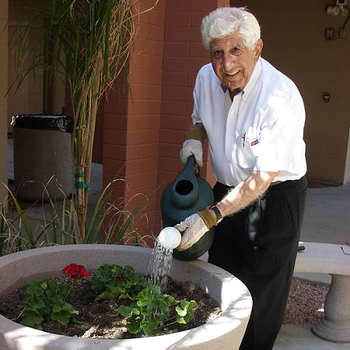 Gus Kapellas watering the plants in the garden