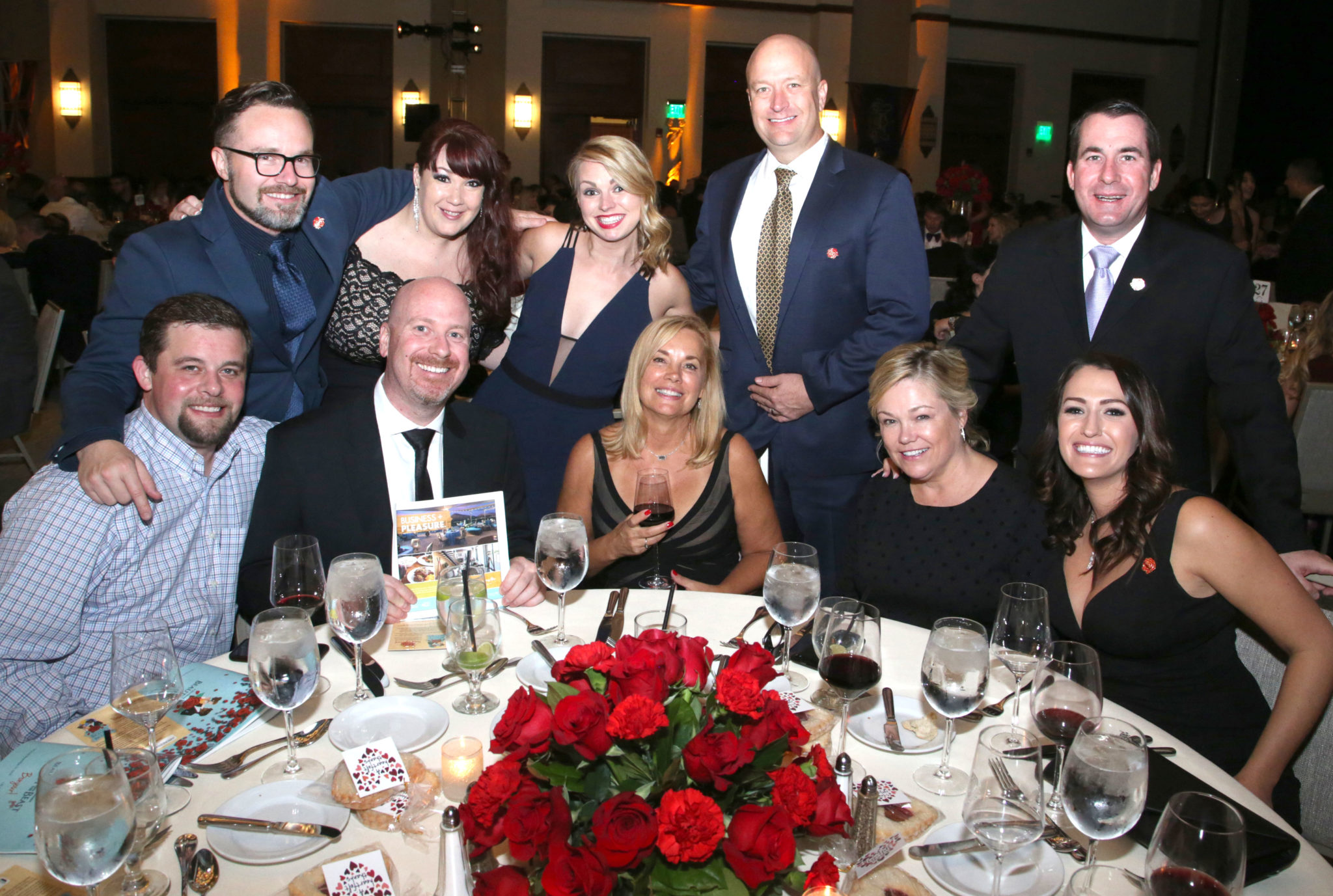 McNight Gala guests from Hotel Valley Ho pose at their table in the Camelback Inn ballroom
