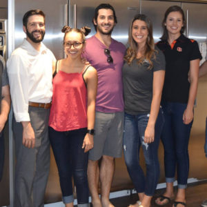Group of Red Shoe Society members pose in the RMHC kitchen