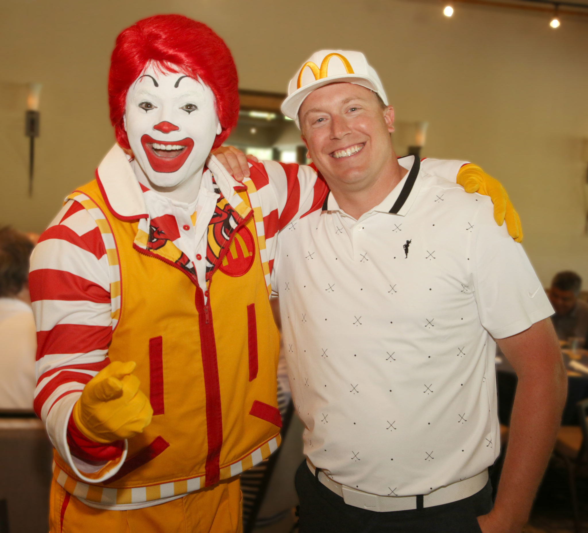 Ronald McDonald poses with RMHC Board Member and McDonald's Owner/Operator Chris Carney